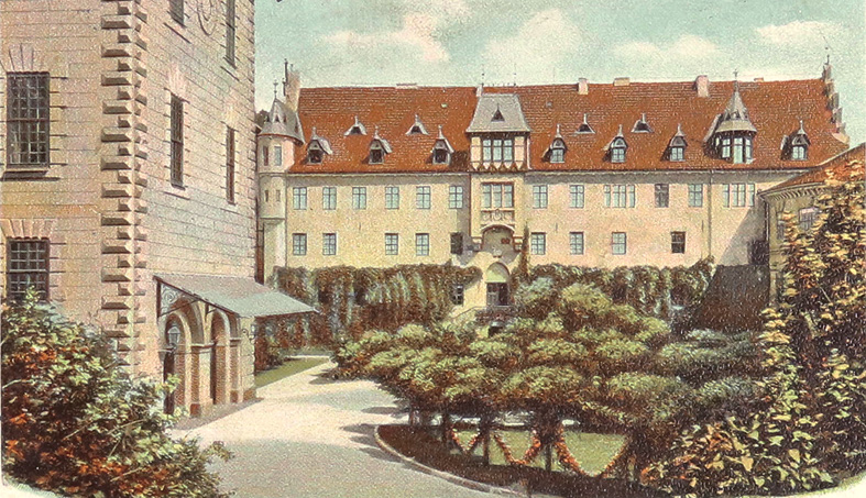 Alte sepiafarbende Postkarte mit Ansicht des Bibrabaus